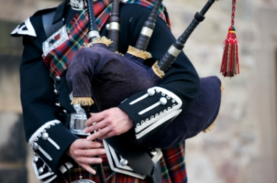 Bagpiper playing the Bagpipes